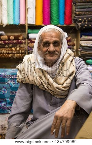 LUXOR, EGYPT - FEBRUARY 10, 2016: Luxor market vendor in his shop posing for camera