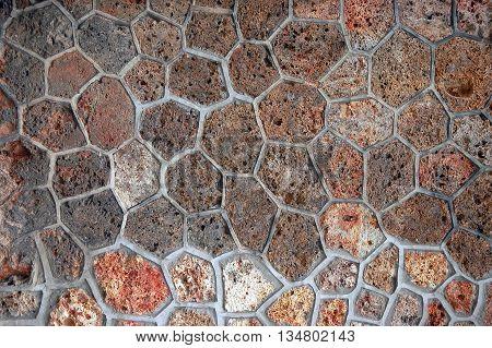 Closeup of sandstone wall honeycomb masonry texture