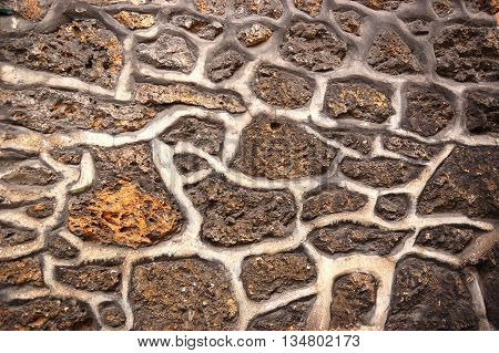 Closeup of sandstone wall masonry irregular texture