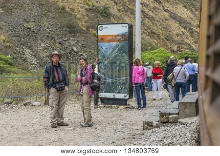 ALAUSI, ECUADOR, OCTOBER - 2015 - Group of tourists waiting to arrive at train at famous Devil Nose tour located in Aluasi town Ecuador