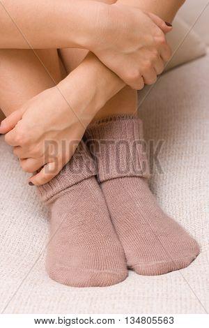 woolen cute socks. Womans feet in wool socks.