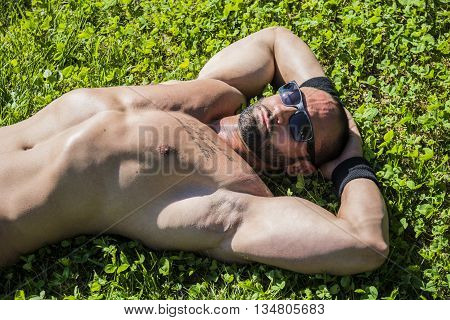 Handsome Muscular Shirtless Hunk Man Outdoor in City Park. Showing Healthy Muscle Body While Looking away