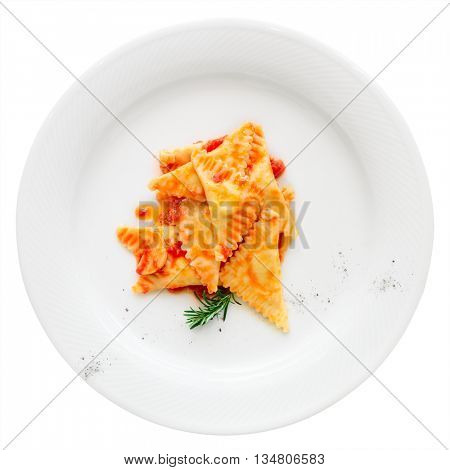 Ravioli with tomato sauce and herbs isolated on white background