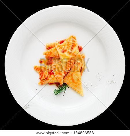 Ravioli with tomato sauce and herbs isolated on black background