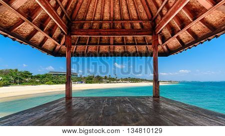 Looking out of hut at a tropical beach on a beautiful sunny day in Bali
