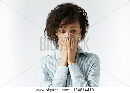 Human Face Expressions. Scared African Woman Wearing Grey Shirt, Looking Shocked And Sad, Closing He
