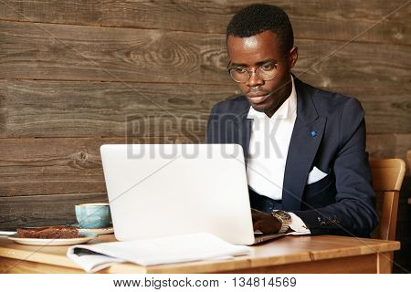 Business And Success. Handsome Successful African American Man Wearing Formal Suit, Oval Glasses And