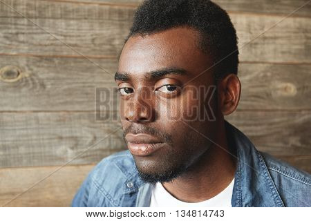 A Half-turned Facial Shot Of Young African American Man With Big Eyes And Little Stylish Beard. Seri