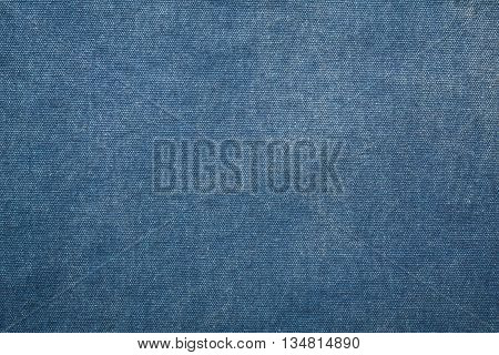 texture of old dark blue fabric canvas for background
