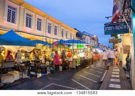 PHUKET THAILAND MAY 29 2016: Tourists shop at night market of Phuket on May 29 2016.among old building Chino Portuguese style street of Phuket town is the famous Phuket and is a major tourist hub.