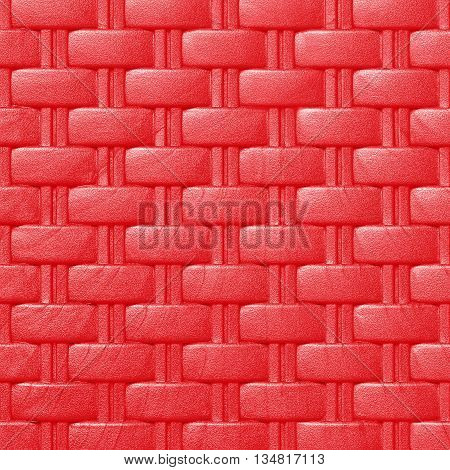 Plastic weave pattern texture and background; red color