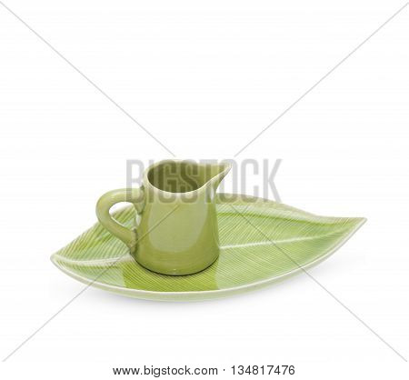 green teapot with saucer isolated on white background