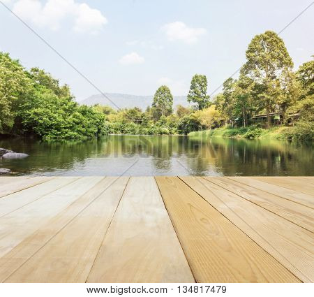 Blank Area Or Space Table Top On River Or Stream View With Mountain And Sky Background, Jointed Wood