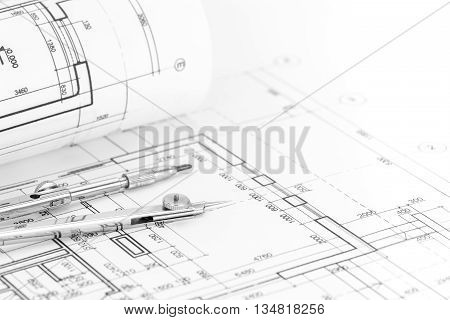 Floor Plan Background With Blueprint Roll And Drawing Compass