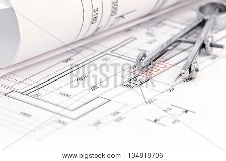 Floor Plan With Rolled Blueprint And Drawing Compass