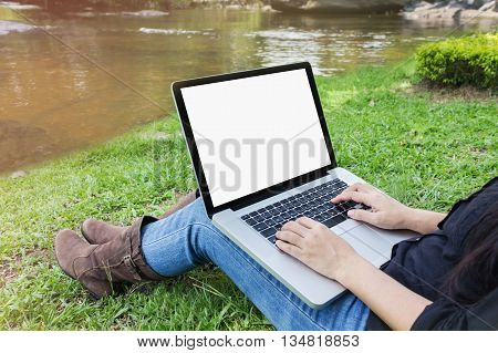 Blank Screen Laptop With Girl Sitting On Grass Field At Riverside, Girl Or Women Surfing Internet In