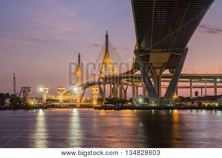 Bangkok, Thailand - January 9, 2016: Bhumibol suspension Bridge in Thailand, also known as the Industrial Ring Road Bridge, in Thailand. The bridge crosses the Chao Phraya River at twilight.