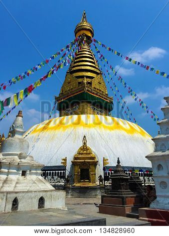 Buddhist stupa and flags in Kathmandu, Nepal religious building stupa decorated with flags