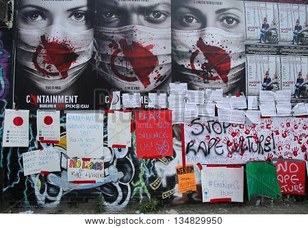 NEW YORK - JUNE 4, 2016: Stop Rape protest signs during Bushwick Collective Block Party in Brooklyn