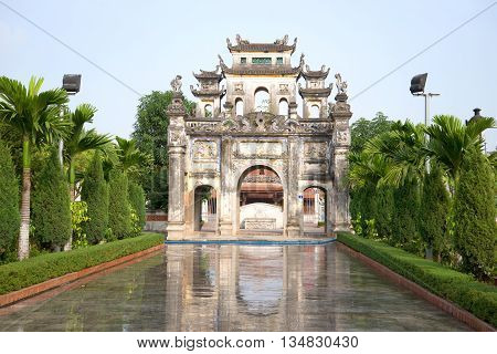 Ancient gate of a Buddhist temple in Snake village (Le Mat snake village), early morning. Hanoi, Vietnam