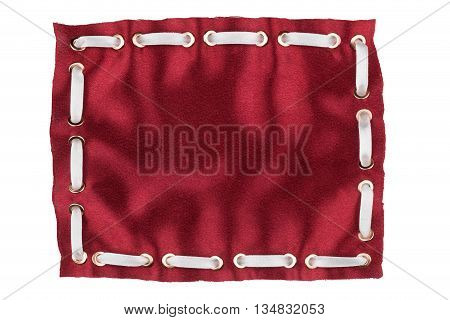 Frame made of red silk with inserted white satin ribbon isolated on white background