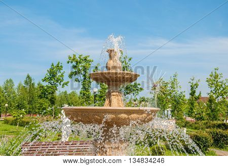 Fountain with jets and spray water in a city park park