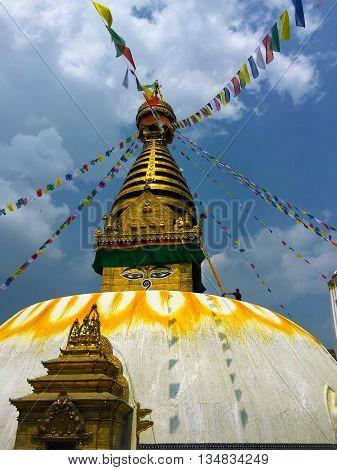 Buddhist temple with flags, buddhist stupa with eyes in Nepal, Sagarmatha stupa in Kathmandu