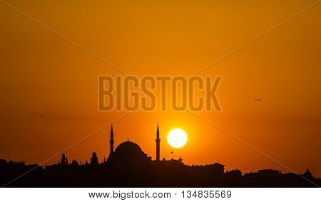 The old mosque and minaret at sunset in Istanbul