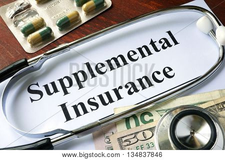 Supplemental Insurance written on a paper.  Medical concept.