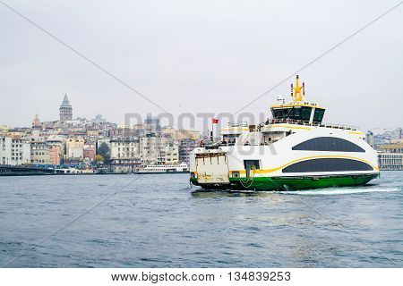 Istanbul ferry on Bosphorus Turkey. Passenger Ferry on Bosporus. Ship on Bosporus with Galata Tower on background. View from Istanbul with Galata Tower and the ferry.