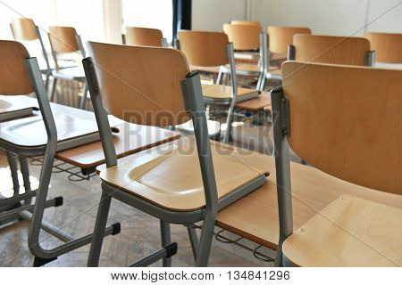Empty classroom with chairs on the desks