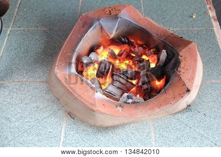 burning charcoal in old stove thailand tradition