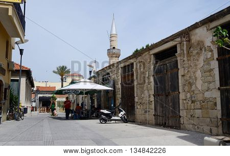 LIMASSOL (LEMESOS) CYPRUS - APRIL 23 2016: Street near mosque in medieval Turkish quarter of old town.It's largest city of Cyprus in geographical size