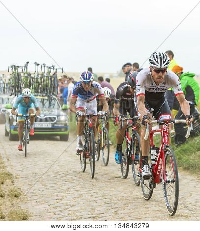 Quievy, France - July 07 2015: The Swiss cyclist Gregory Rast of Trek-Segafredo Team riding in the peloton on a cobblestone road during the stage 4 of Le Tour de France 2015 in Quievy France on 07 July2015.