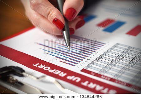 Woman Hand Checks Start Up Report
