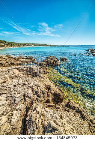 rocks by the shore in Le Bombarde beach Sardinia
