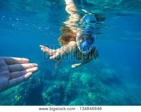 Woman snorkeling in blue mask, snorkel woman face in mask, summer vacation activity