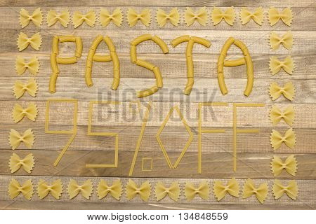 pasta ninety five percent off text made of raw pasta on wood