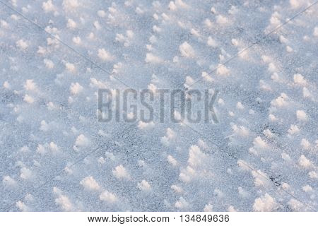 Closeup of a field of snow flakes or crystals in winter