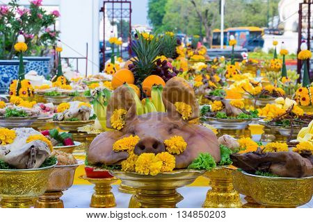 Boiled pig's headsducks and chickens decorated with flowers in ceremony to salute the Bangkok City Pillar ShrineThailand.