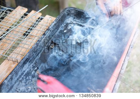 charcoal fire for BBQ Preparing the barbecue grid for tasty meat