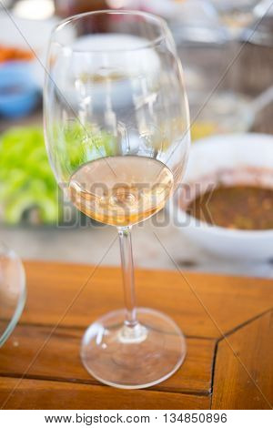 white wine on table with food background