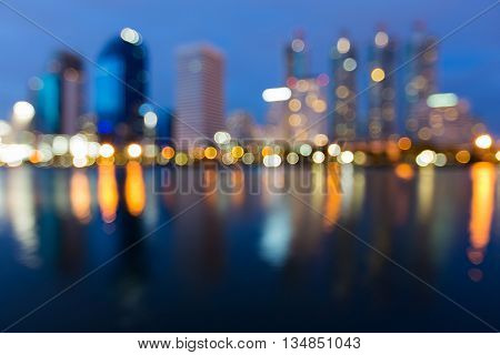 Reflection of blurred lights office building at twilight