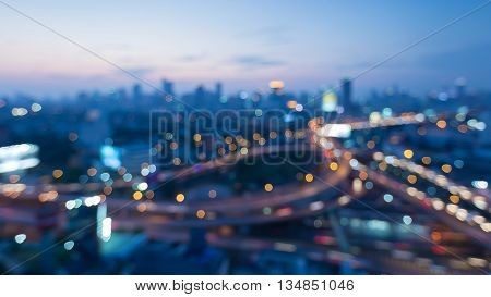 Blurred bokeh lights city interchanged and city downtown background night view