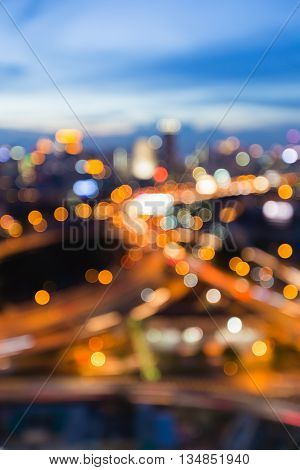 Blurred bokeh lights city downtown background and highway intersection skyline