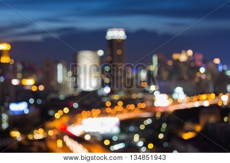 Blurred lights city downtown and highway at twilight, abstract background