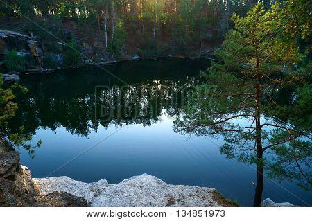 Beautiful lake at the bottom of the canyon at sunset