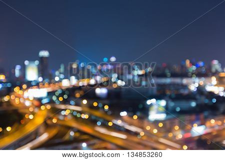 Blurred lights, city road interchanged and office building background, night view