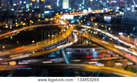 Blurred bokeh lights city highway interchanged night view, abstract background