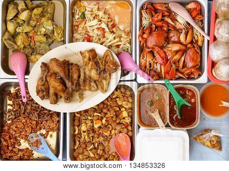 Variety of delicious Malaysian home cooked dishes sold at street market stall in Kota Kinabalu Sabah from top angle view.